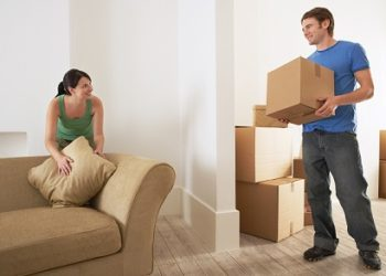 happy couple while moving